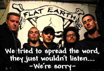 People in front of a Flat Earth poster saying they're sorry for electing Bush